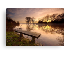 A bench with a view. Canvas Print