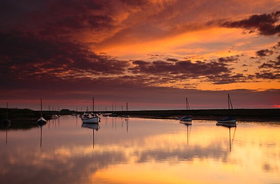 Red Sky Over Burnham Overy by Rick Bowden