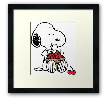 Snoopy eats Cherry Framed Print