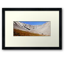 Meadows under rocky walls Framed Print