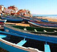 Blue fishing boats in Ahrud near Agadir, Morocco by Digital Editor .