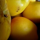 bowl of yellow apples by tego53