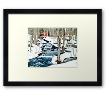 Waterfall cascading down snowy slope. New England winter scene Framed Print