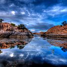 Reflection on the Rocks by Bob Larson