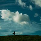 Day after day, alone on the hill The man with the foolish grin is keeping perfectly still by Tony Day
