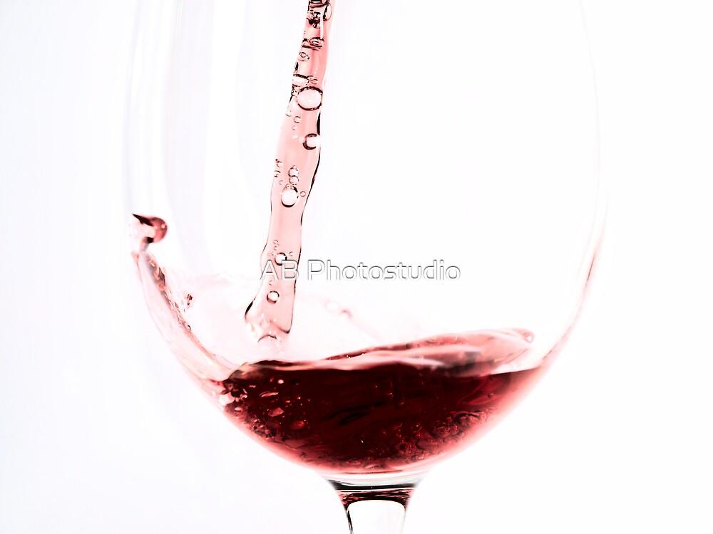 Red wine into wine glass by Arve Bettum
