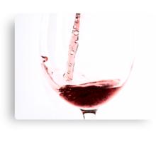 Red wine into wine glass Canvas Print