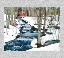 Waterfall cascading down snowy slope. New England winter scene Kids Clothes