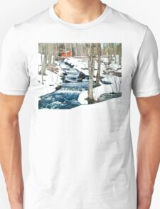 Waterfall cascading down snowy slope. New England winter scene T-Shirt
