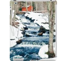 Waterfall cascading down snowy slope. New England winter scene iPad Case/Skin