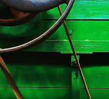 flywheel on green peanut picker by Mark Malinowski