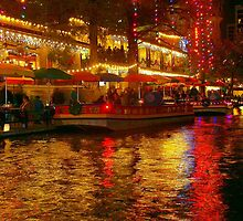 Christmas lights on the San Antonio River Walk by kellimays