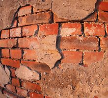 Fragment of an old shabby brick wall by vladromensky