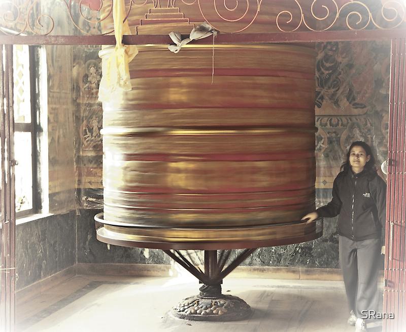 Going around prayer wheel by SRana