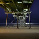 Beneath Saltburn pier with floodlights by Phillip Dove
