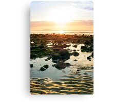 serene reflections at rocky beal beach Canvas Print