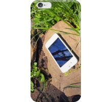 Smartphone on a rock in a meadow iPhone Case/Skin