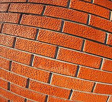 Wall of decorative red bricks close up by vladromensky