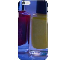 Close up of blue, red and yellow nail polish iPhone Case/Skin