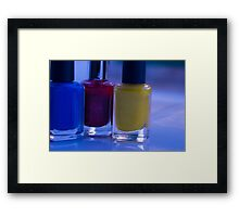 Close up of blue, red and yellow nail polish Framed Print