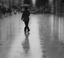 Dancing in the rain on the Champs-Élysées (Paris, France) by Christine Oakley