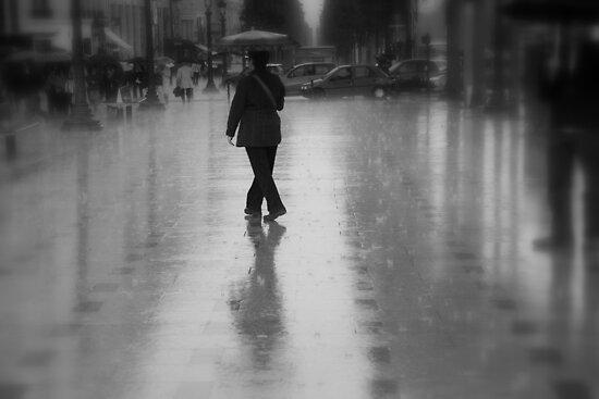 Dancing in the rain on the Champs-Élysées (Paris, France) by Christine Oakley