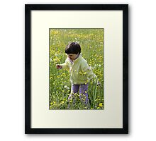 A happy child among the flowers Framed Print