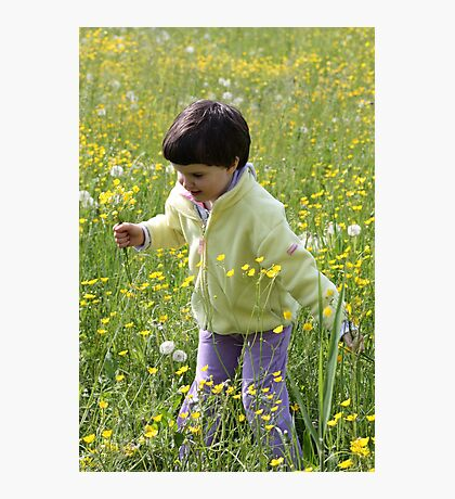 A happy child among the flowers Photographic Print