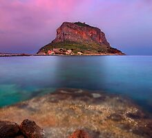The rock of Monemvasia under a purple sky by Hercules Milas