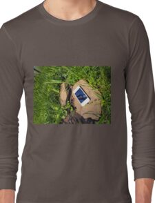 Smartphone on a rock in a meadow Long Sleeve T-Shirt