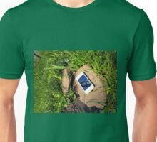 Smartphone on a rock in a meadow Unisex T-Shirt