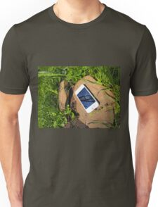 White smartphone on a rock in a meadow Unisex T-Shirt