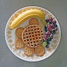 WAFFLES, BANANA, GRAPES, AND CRACKERS. by FoodMaster