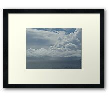 Clouds over a tranquil sea in the Whitsunday Islands Framed Print