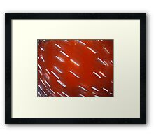 White LED light bulb on a red wall blurred in motion Framed Print