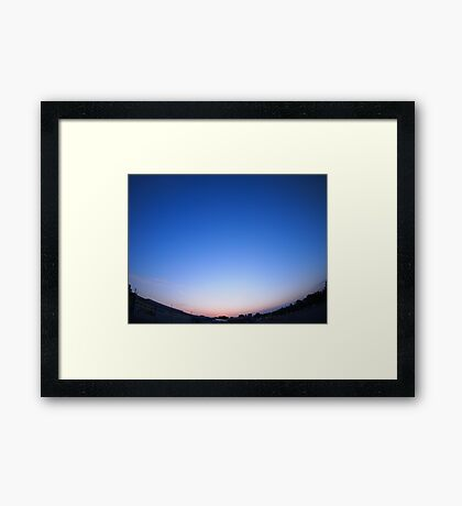 Clear skies over the city after sunset Framed Print