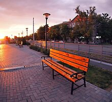 European urban sidewalk, benches and lanterns in the evening by vladromensky