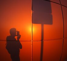 The shadow of a man on a red-orange wall by vladromensky