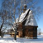 Wooden church in winter by Yulia Manko