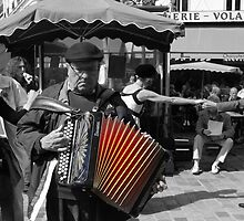 Street musician (Paris, France) by Christine Oakley