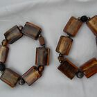 Flintstones With Class Bracelets - Brown Stones by sylversorceress