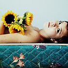Girl in Bed with Sunflowers by Loren Carlile