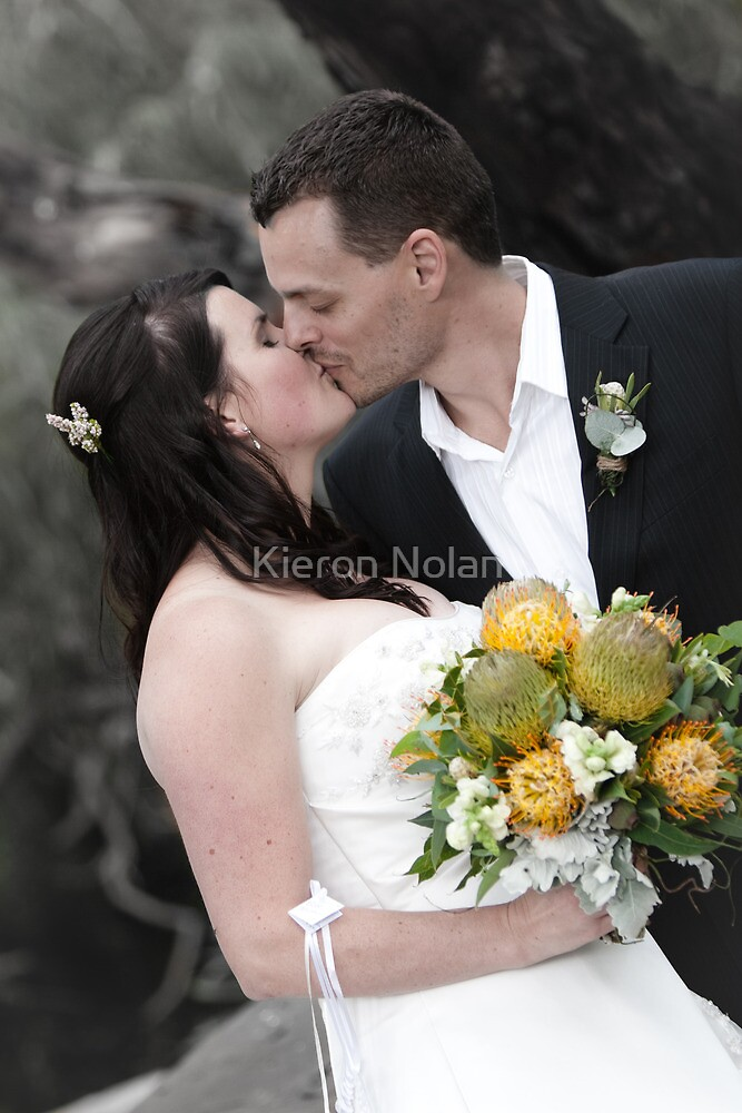 Newly wed kiss by Kieron Nolan