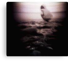 Shots on a cold beach, drawn to the edge. Canvas Print