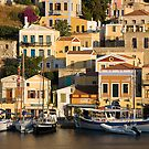 Symi island (Greece) - the picturesque toy-like harbor by Yannis Larios