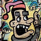 Graffiti man on the textured brick wall by yurix