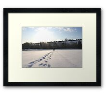Footprints in the snow Framed Print