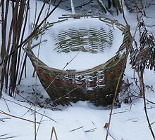 Basket full of snow by mariamagdalena