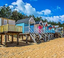 Coloured Beach Huts 3 by Chris Thaxter