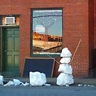 SNOWMAN ON A TOWN STREET by BCallahan